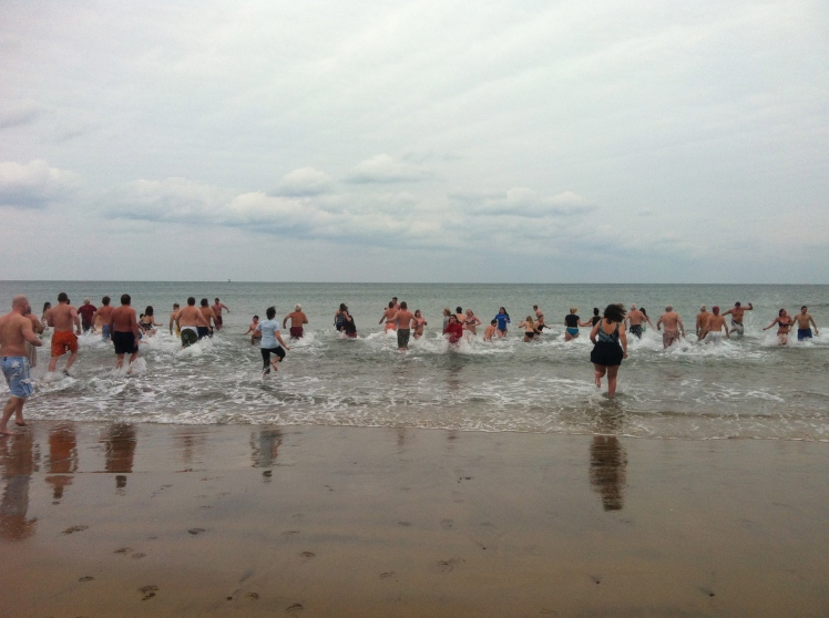 About 100 into the water, twice as many on the beach to watch.