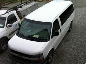 The van - parked beside Callum's work truck. The van is quite big.