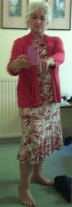 taking picture of myself in mirror to show I can wear a dress - usually in trousers