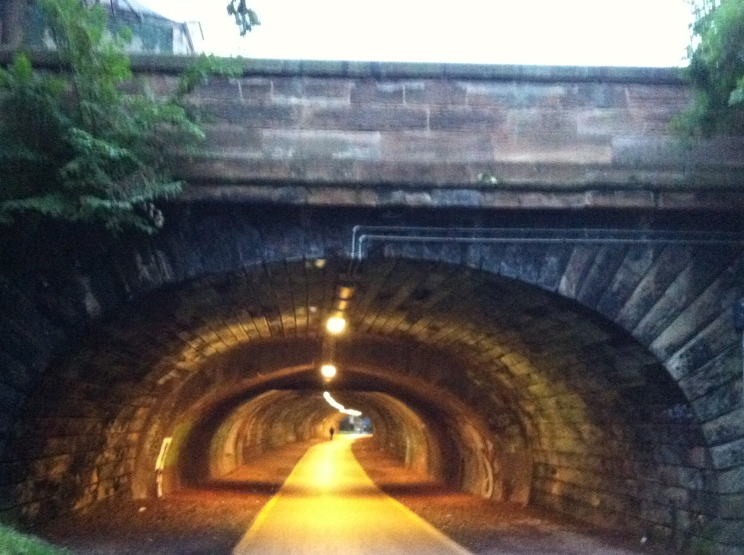 A disused rail tunnel, now the brickwork is lit up for walkers