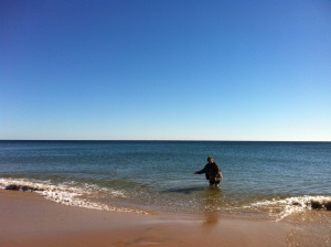 Faye trying the water on a beautiful BI beach walk